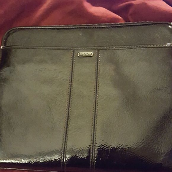 Coach tablet case Back patent leather Coach tablet case. Black exterior w pink interior.  Has pockets on inside and has black patent Coach hangtag. Light smudges on front only visible at certain angles. Coach Bags Cosmetic Bags & Cases
