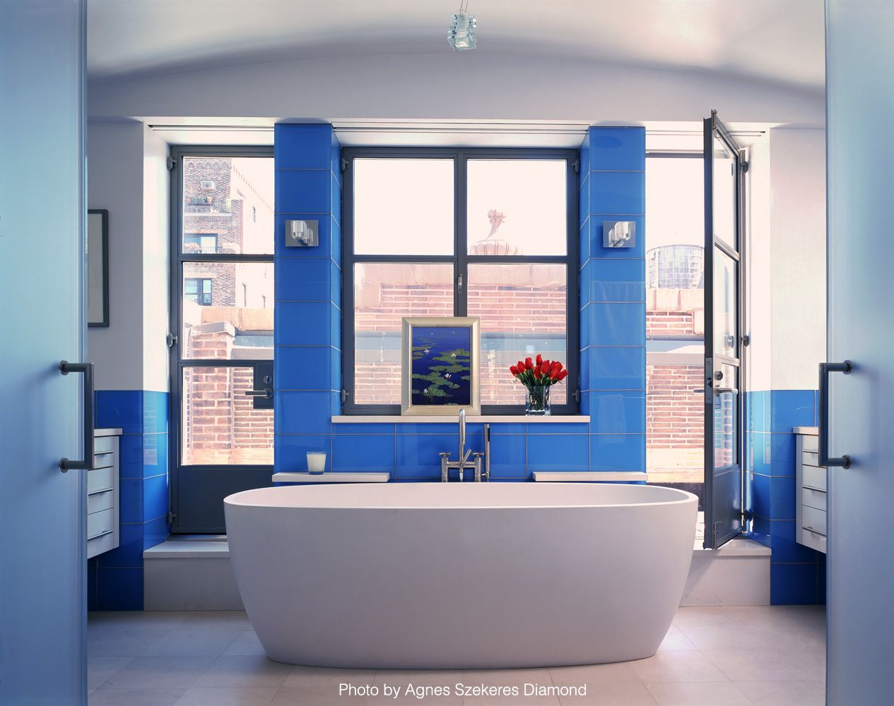 Images Photos The freestanding tub is being the norm in all remodeled bathrooms The blue walls and