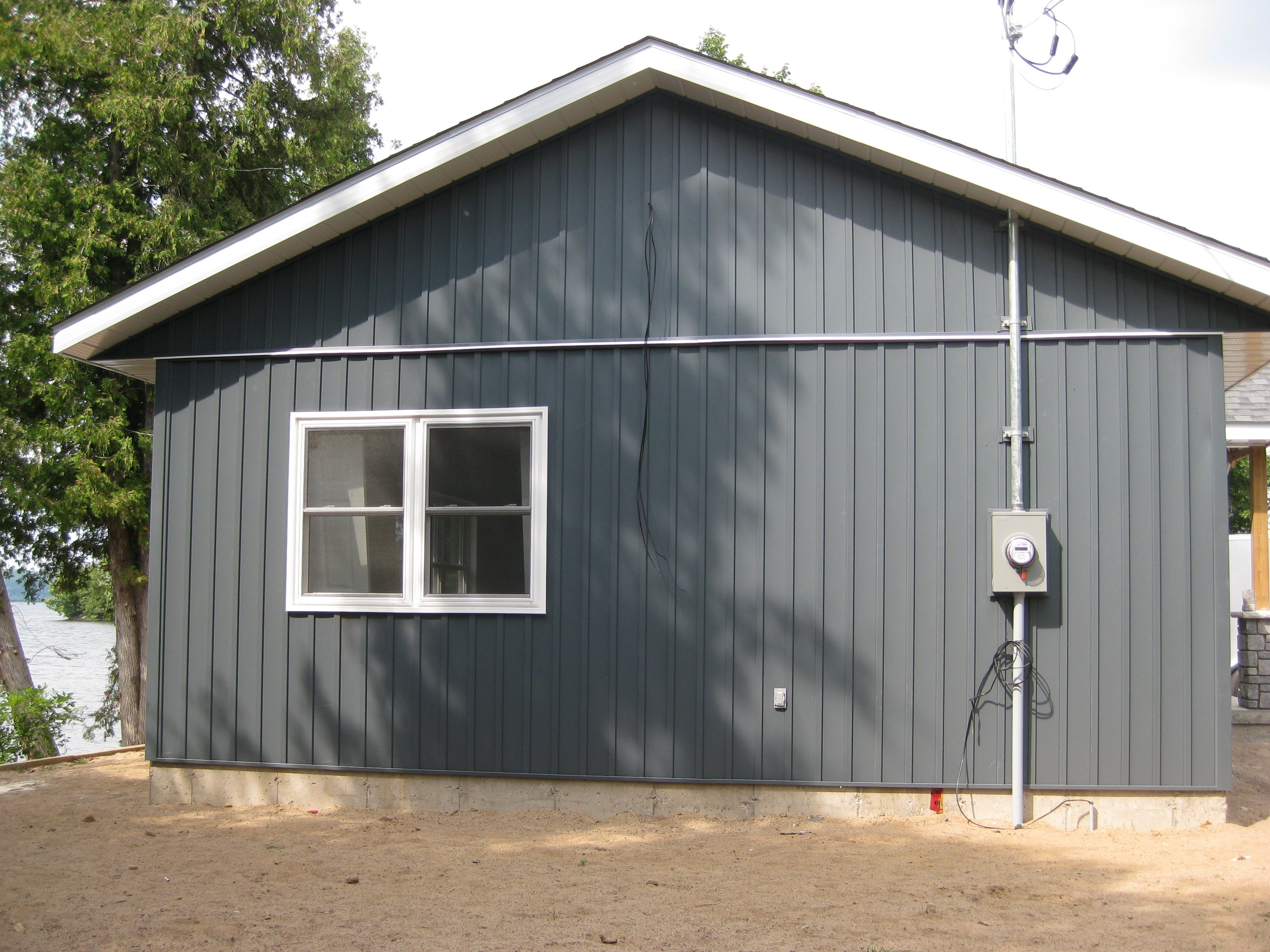 Midnight Surf Siding With White Trim Renovated By