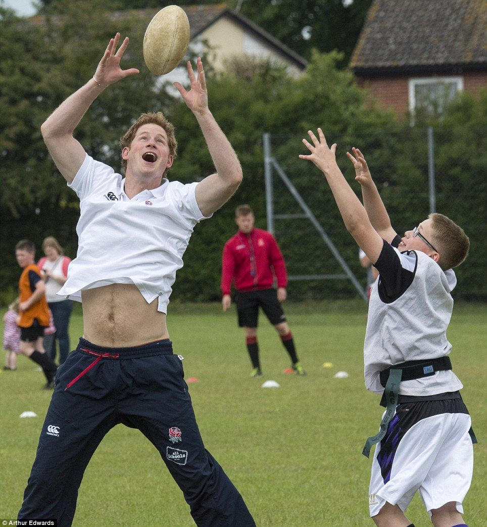 Actively involved: There was no royal treatment for Harry as he got stuck into the game...