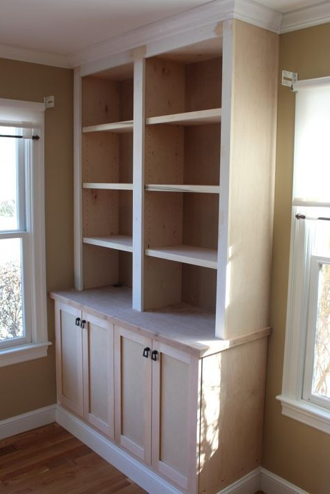 DIY builtins bookcase with base cabinets from the big box store