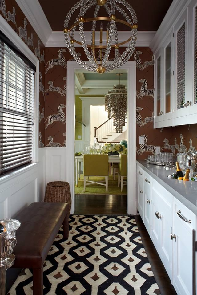 Such a fun butlers pantry and beautiful lighting!