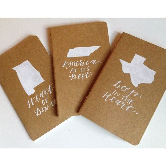 Moleskine pocket notebooks, personalized with state shape and slogan by Stately Made