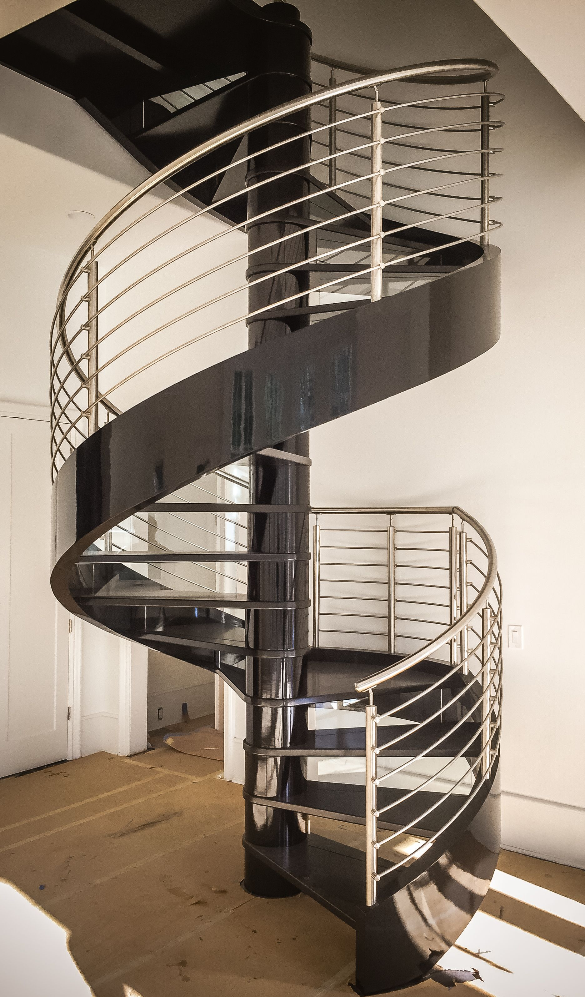 Stainless steel open riser spiral staircase.