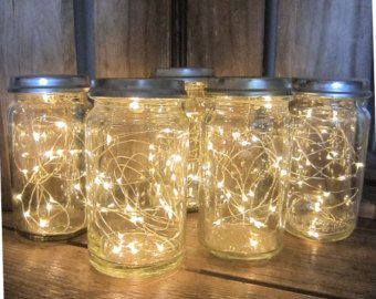 These Amazing Firefly Jars Are The Perfect Centerpiece For Your Country Wedding Use Jars Of Varyi Vase With Lights Wedding Lights Wedding Table Centerpieces