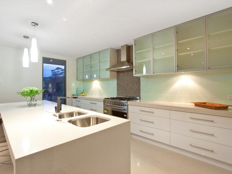modern open plan kitchen design using tiles - kitchen photo 165359