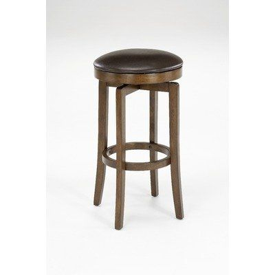 """Brendan Backless 25"""" High Counter Stool by Hillsdale. $129.00. Brown Cherry. Style Traditional. Color Brown. Assembled Dimensions 25 in. H x 17 in. W x 17 in. D. Pull this stylish Brendan backless counter stool up to your kitchen counter or bar for a seating solution that is both comfortable and convenient. Its armless and backless design makes it ideal for nearly any environment. This casual design is enhanced by its four slightly flared legs and rich, brown faux leather..."""