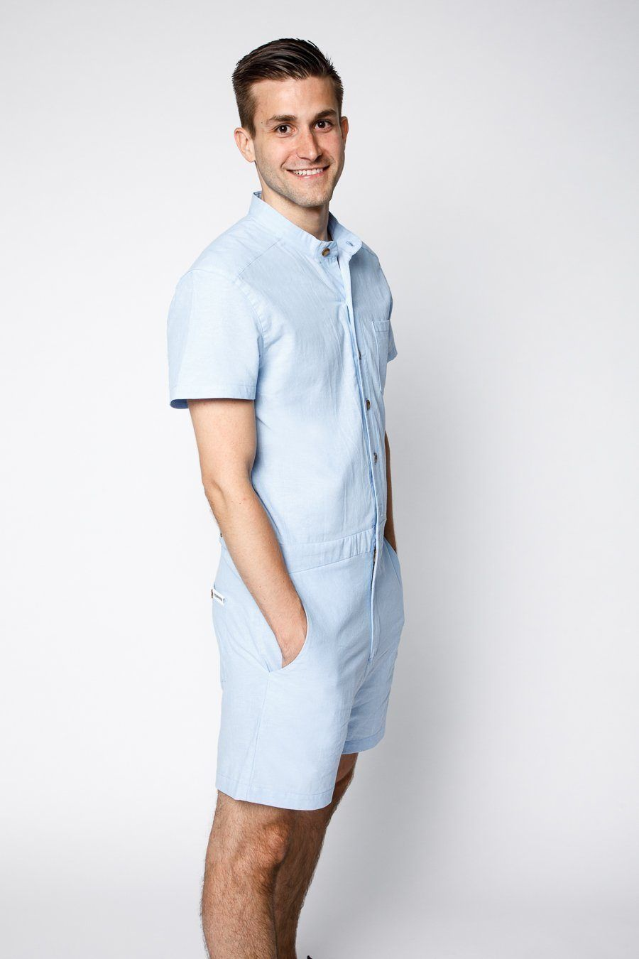 eceda1604f37 Product shot of model wearing Light blue chambray male romper by RompHim  (side view)