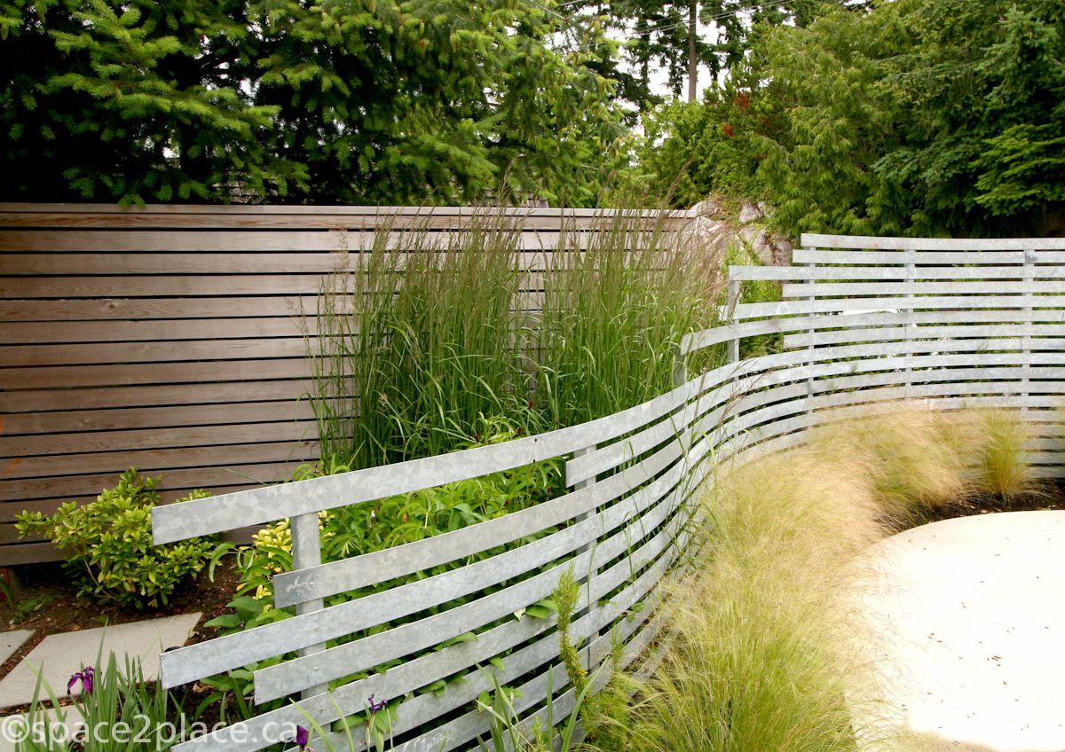 Curving Metal Slat Fence