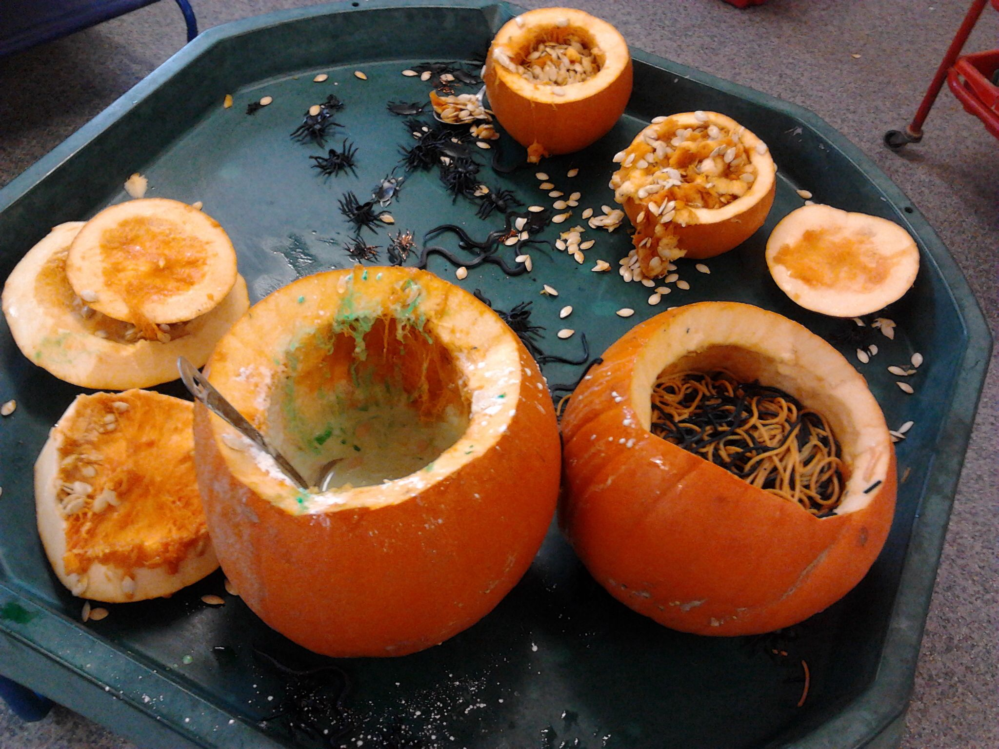 Pumpkin filled messy play with spiders, worms and green gloop
