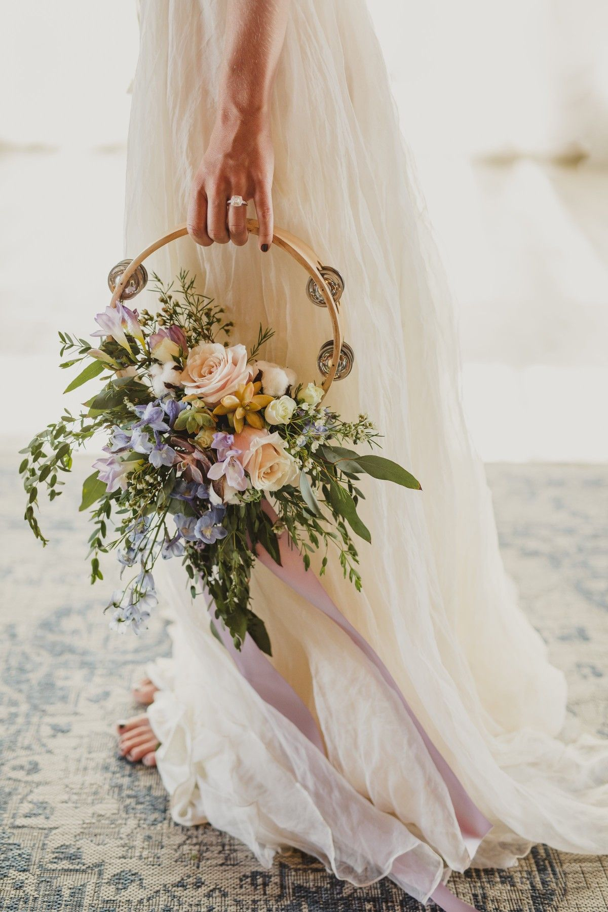Unique Tambourine Bridal Bouquet With Succulents Nestled