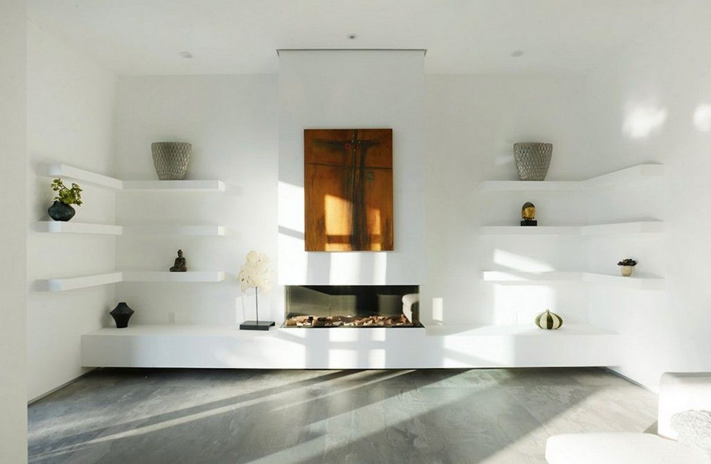 modern fireplace with white wall and wall shelves also concrete floor to create a