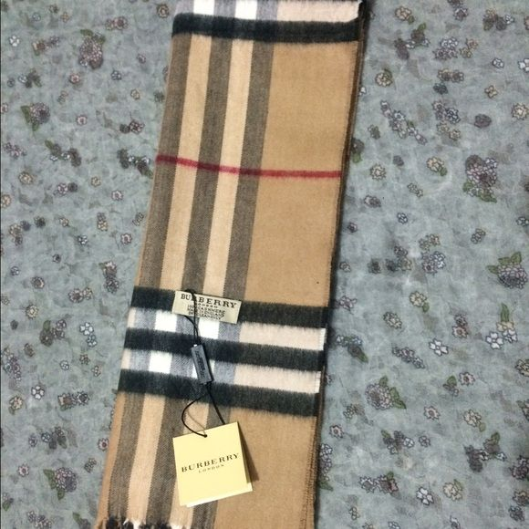 Authentic Burberry Scarf Camel With defects Authentic Burberry Scarf Giant Check Camel With defectsStyle: Scarf Brand : Burberry Color : Camel Material : 100% Cashmere Made in EnglandNo Trade Burberry Accessories Scarves & Wraps