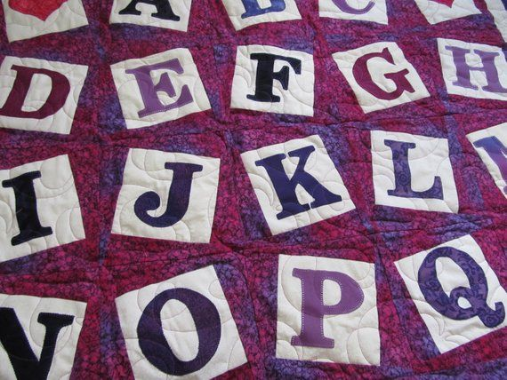 I designed this alphabet baby quilt with applique letters that twist