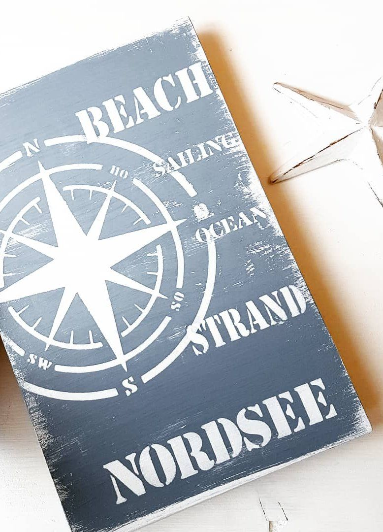Photo of Wooden shield North Sea with compass star handmade