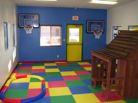 playroom area with floor puzzle Childrens Playroom in The House