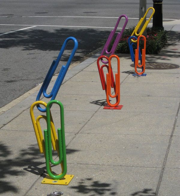 """Clip Art"", the new bike rack - Washington  - USA - July  23, 2010 -  As part of its ongoing beautification program to bring public art and install more bike racks in the city, the Golden Triangle Business Improvement District (BID) unveiled a new artistic bike rack at the corner of 21st  and L streets NW. It features three colorful structures formed in the shape of  nine oversized paper clips, which can hold six locked bikes."