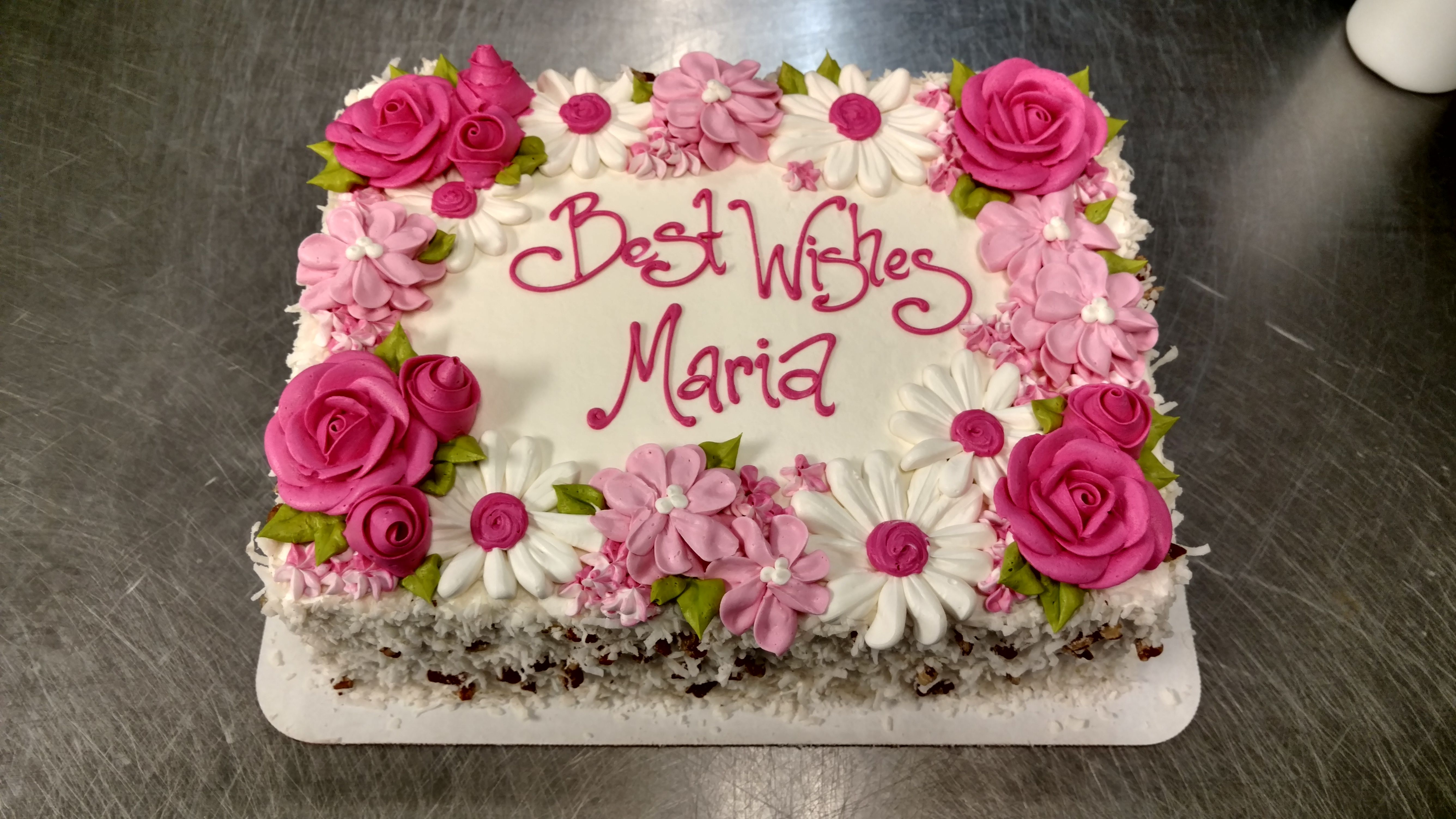 A Quarter Sheet Cake With Buttercream Flowers In A Range