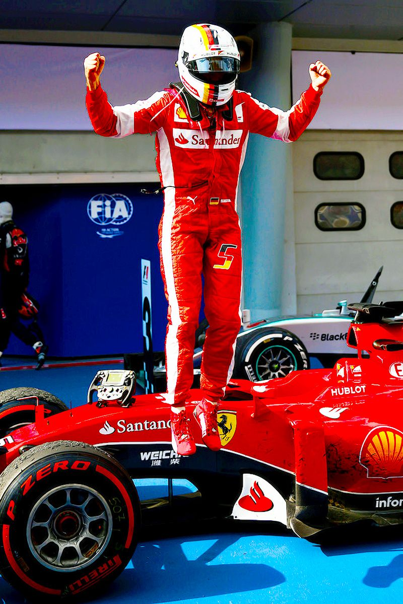Sebastian Vettel ( Ferrari ) First Place in Malaysia. He's celebrating First Place in Parc Ferme
