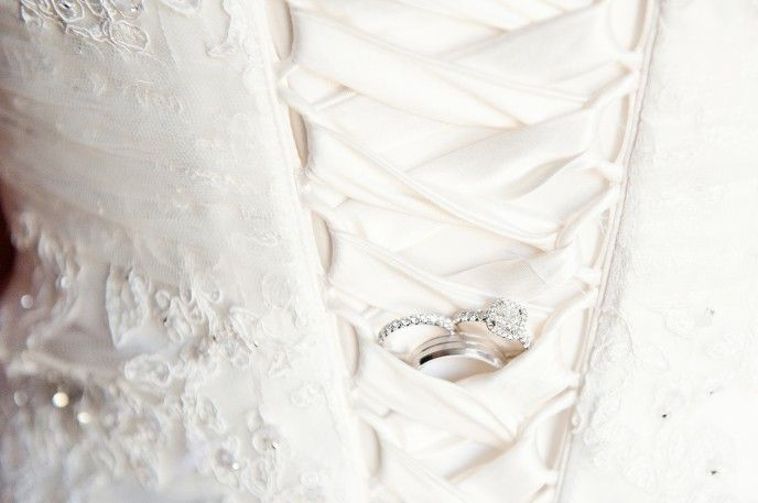 Some of my favorites from Kait & Dan's April Wedding! rings in the dress corset lace