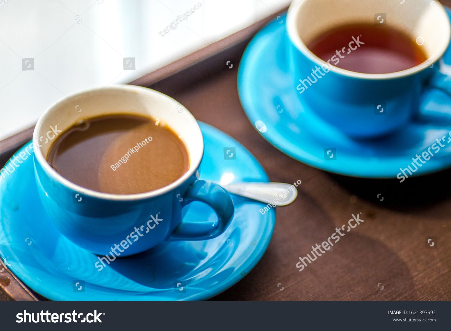 Blurred background view of a mug or coffee cup, a cup of water or a drink on the table, for customer service in a room or restaurant #Sponsored , #ad, #mug#coffee#cup#Blurred
