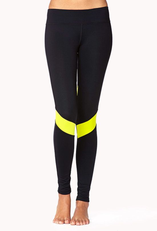 112c1fcb34b3a Forever 21 Colorblocked Leggings: The sun disappears quick if you run after  work, so wearing leggings with high visibility — like these bright Forever  21 ...
