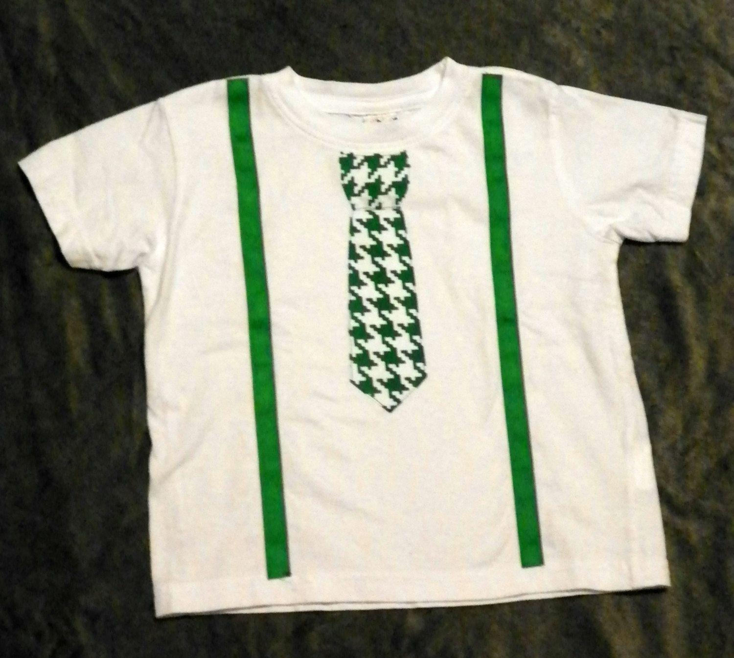 Short sleeve white t-shirt or onesie with green and white tie or bow tie and green ribbon suspenders appliqued. boutique, unique, custom by WinklesWhimsies on Etsy