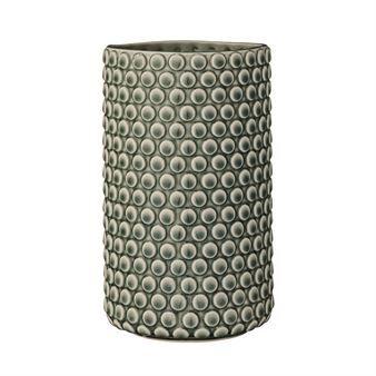 Koristeellinen pallopintainen, sylinterinmuotoinen maljakko tulee tanskalaiselta Bloomingvillelta.