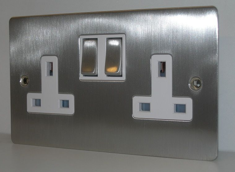 Flat plate 2 gang double 13 amp double pole switched socket is in a brushed chrome
