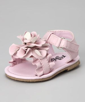 Bring on bright days with a strappy sandal suited for sun-ready sweeties. These pretty little shoes feature an adjustable strap at the ankle and a flourishing blossom at the toe.