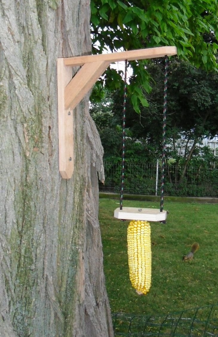 Adorable ear corn trapeze style squirrel feeder with mounting L bracket.