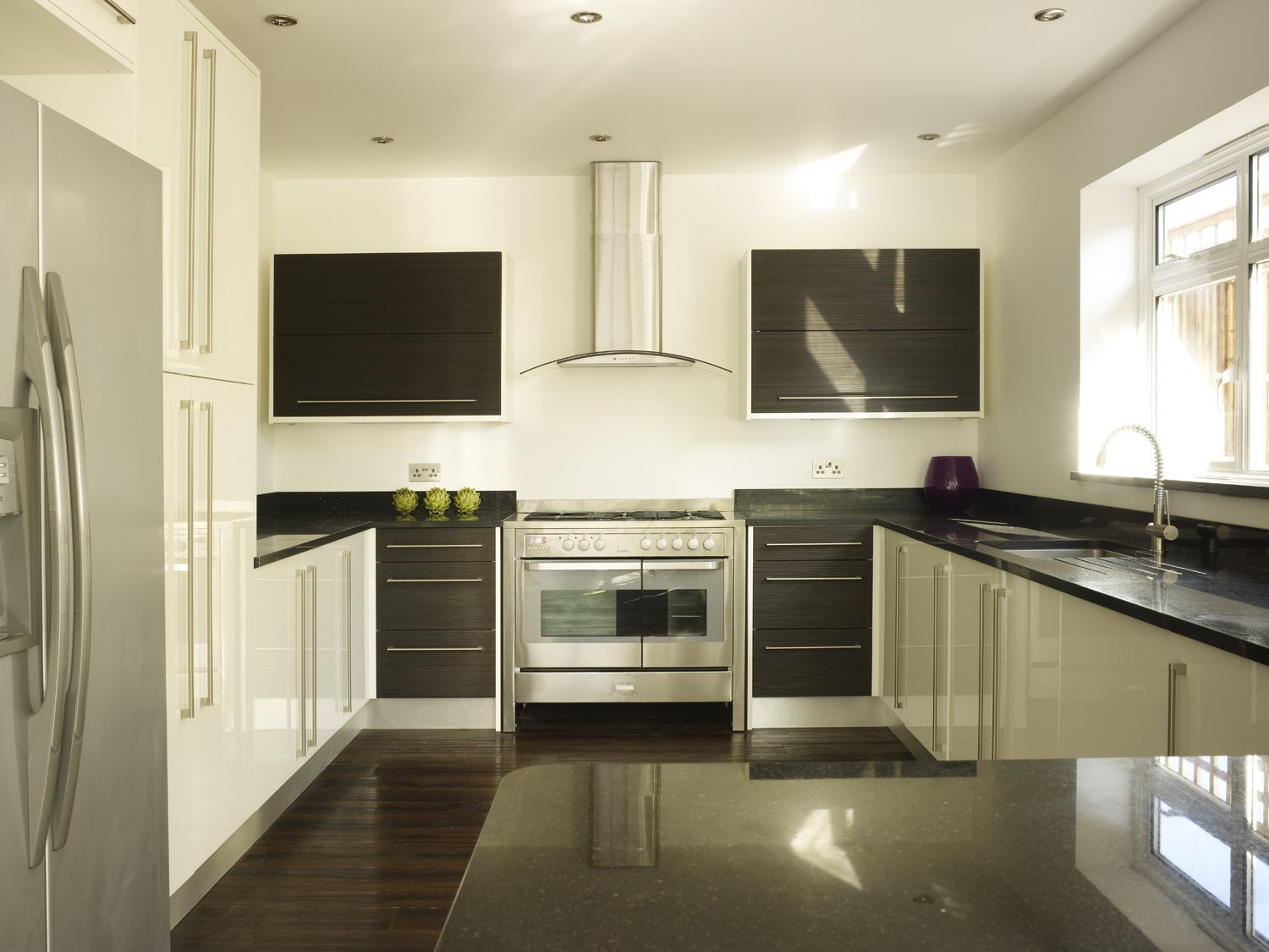 Contemporary white kitchen with black Star Galaxy granite worktops ...