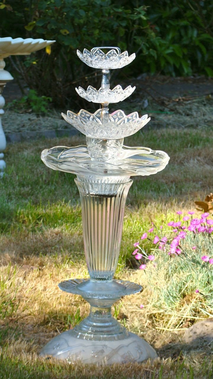 vintage glass light shade repurposed into a bird bath outdoor
