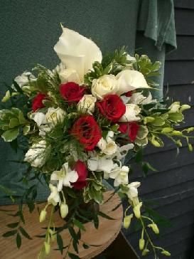 White roses, dendrobium orchids, red roses