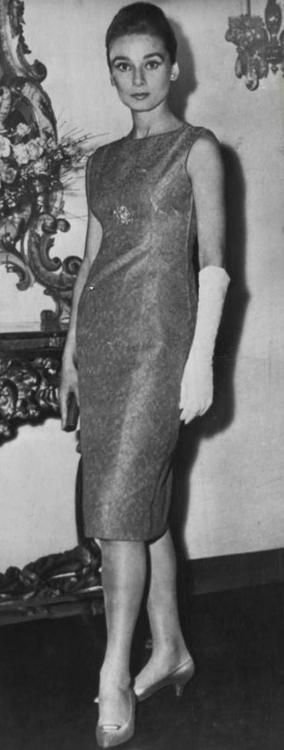 The actress Audrey Hepburn photographed by Jim Pringle at the Hotel Hassler, Trinita dei Monti, Rome (Italy), on January 08, 1960.    -Audrey was wearing a creation of Hubert de Givenchy (evening dress, of his collection for the Autumn/Winter 1959/60) and shoes of Roger Vivier for Christian Dior.