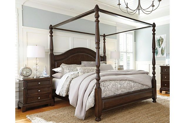With Distinctive Elements Including Turned Posts A Sweeping Camelback Headboard And Beautifully