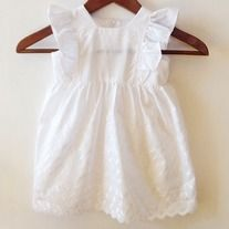 || This tea party dress features an adorable ruffle sleeve and an embroidered pattern throughout. It is handmade, in the USA, using 100% cotton making it super soft for your little ones! ||   Color: White