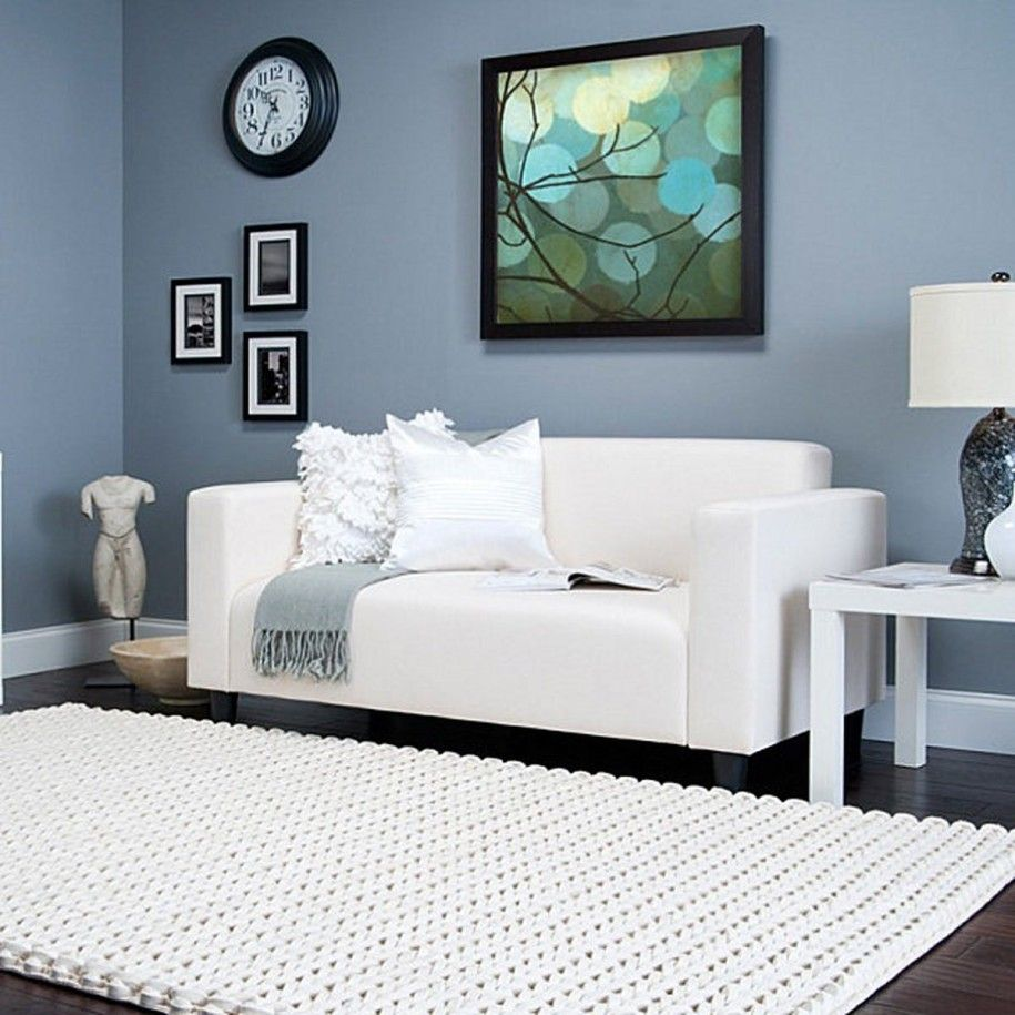 Blue Walls Living Room cream-knit-rug-in-comfortable-living-room-with-dark-blue-wall-and