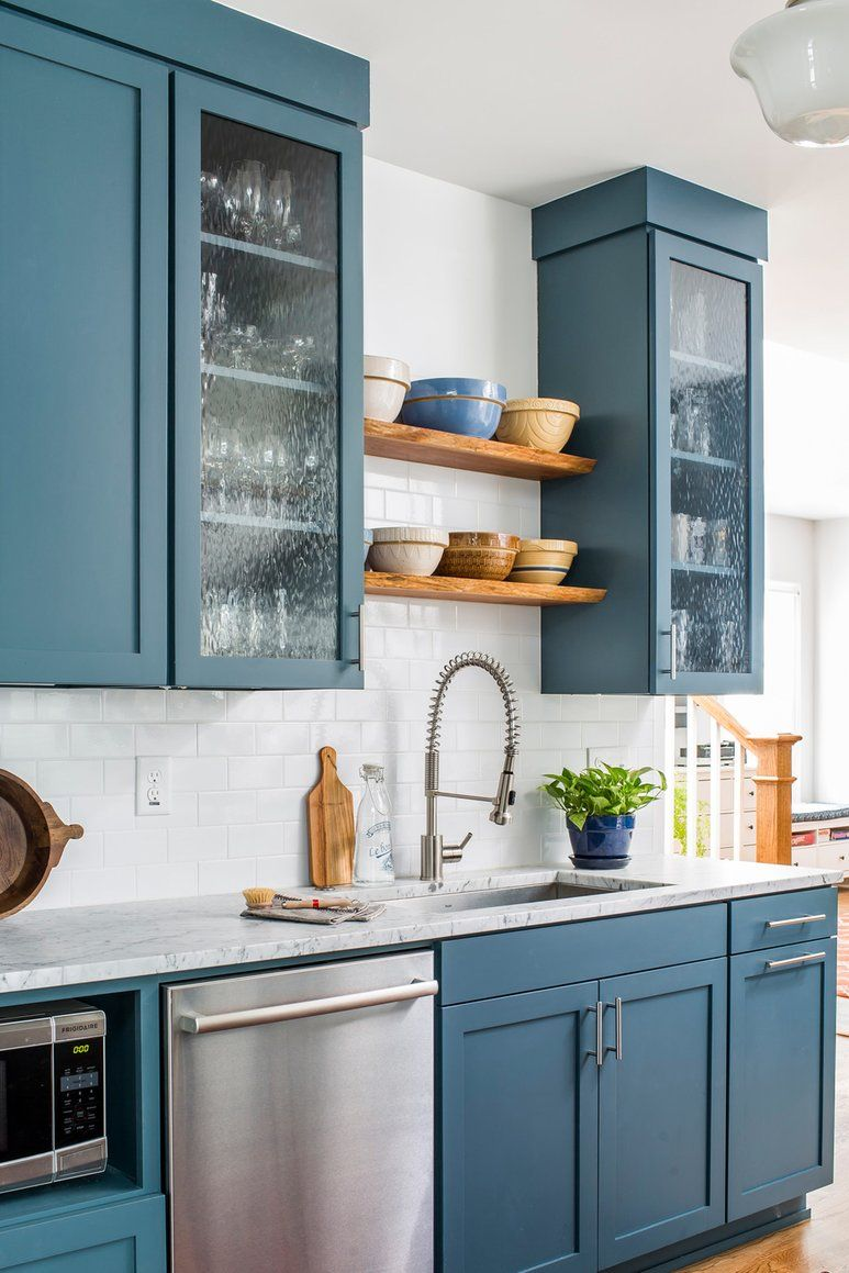 Dusty blue kitchen with walnut open shelving