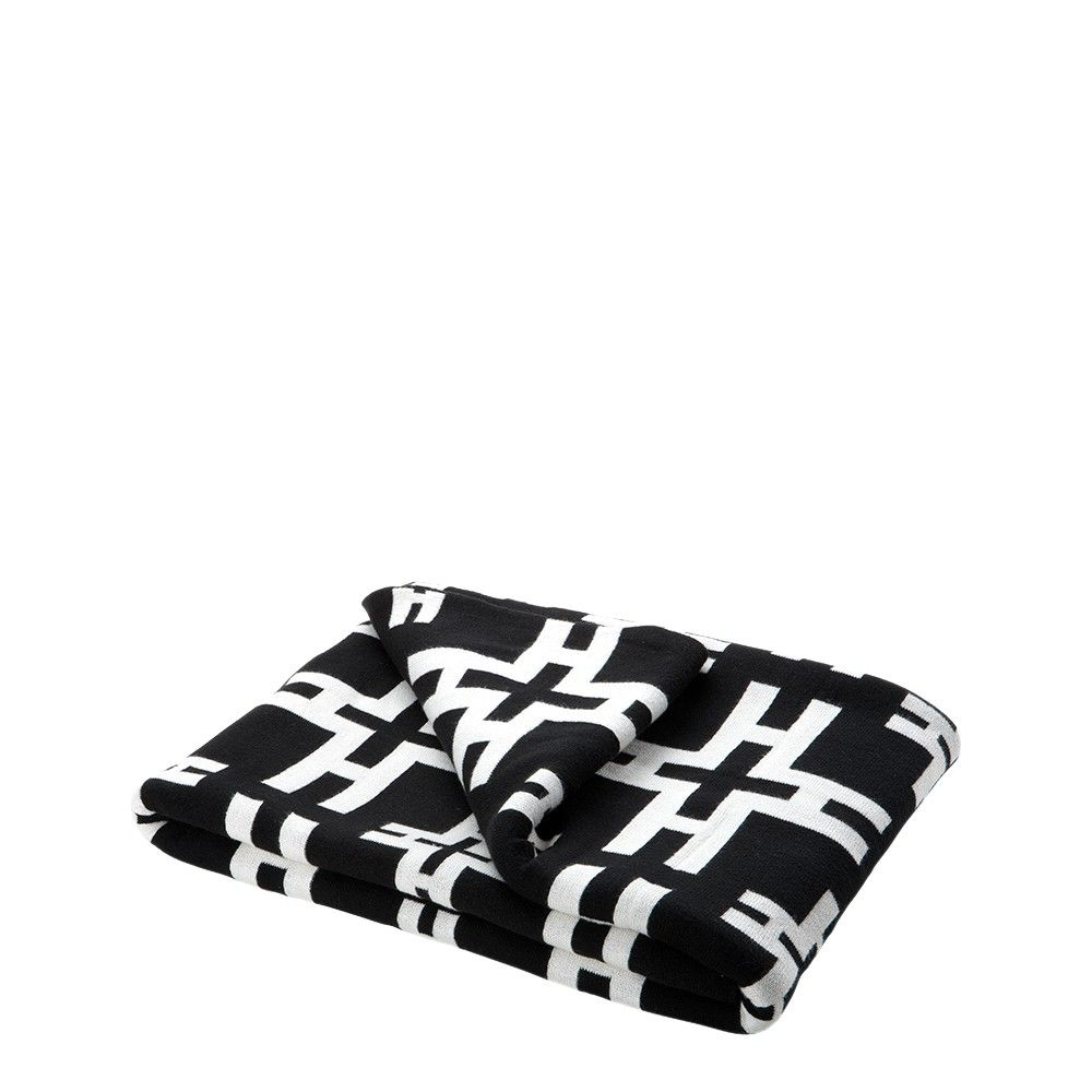 Black and white geometric throw. Eichholtz luxury cotton throw with bold graphic pattern which is perfect for adding fabulous style to home interiors. Place across sofas, armchairs or beds to dress and enjoy a glamorous Eichholtz inspired lifestyle.