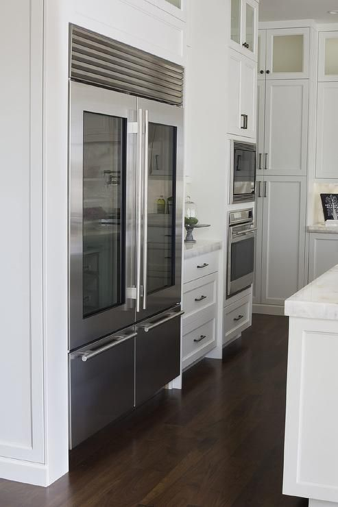 Exceptional Kitchen Features An Industrial Style Refrigerator With Two Glass Front Doors As Glass Door Refrigerator Industrial Kitchen Design Glass Door Fridge