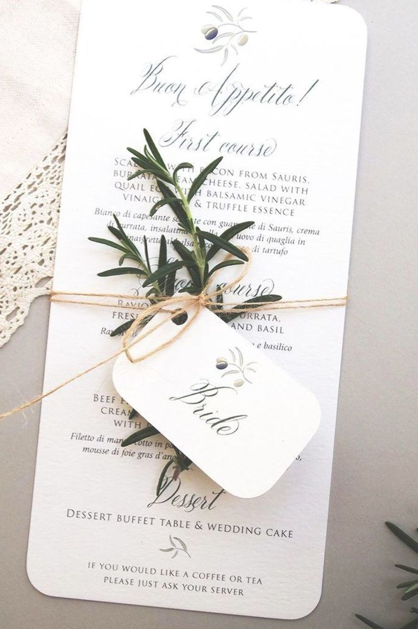 Italian wedding menu and place name card tag tied together with rosemary sprig