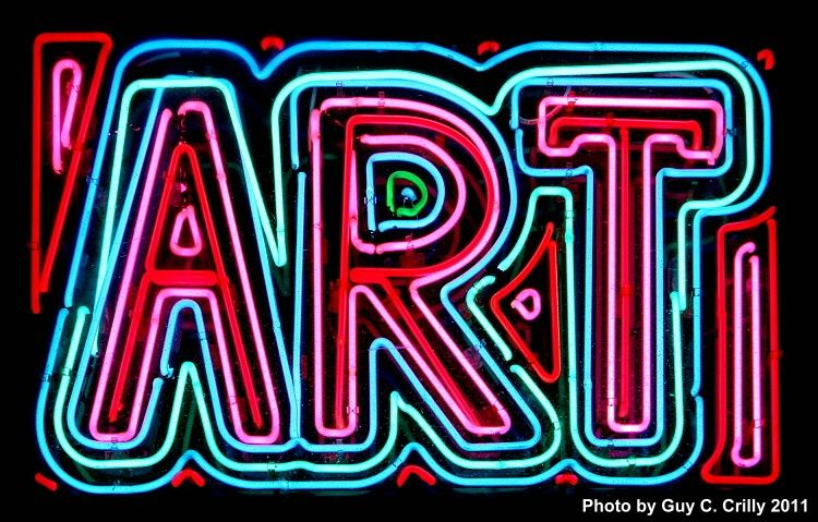this neon art sign hangs above the door to the entrance of the