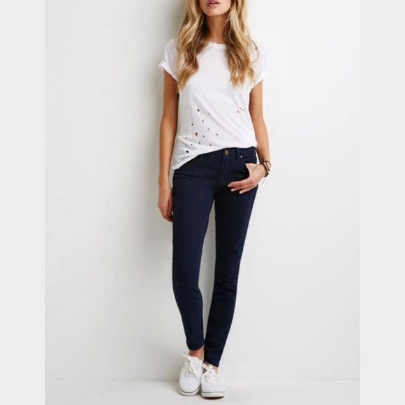 F21 Navy Skinny Pants NWOT Navy Blue Skinny Pants. Mid rise. Soft material.  (Model's picture is actual picture of pants) ✨ALWAYS willing to consider offers✨ Forever 21 Pants Skinny