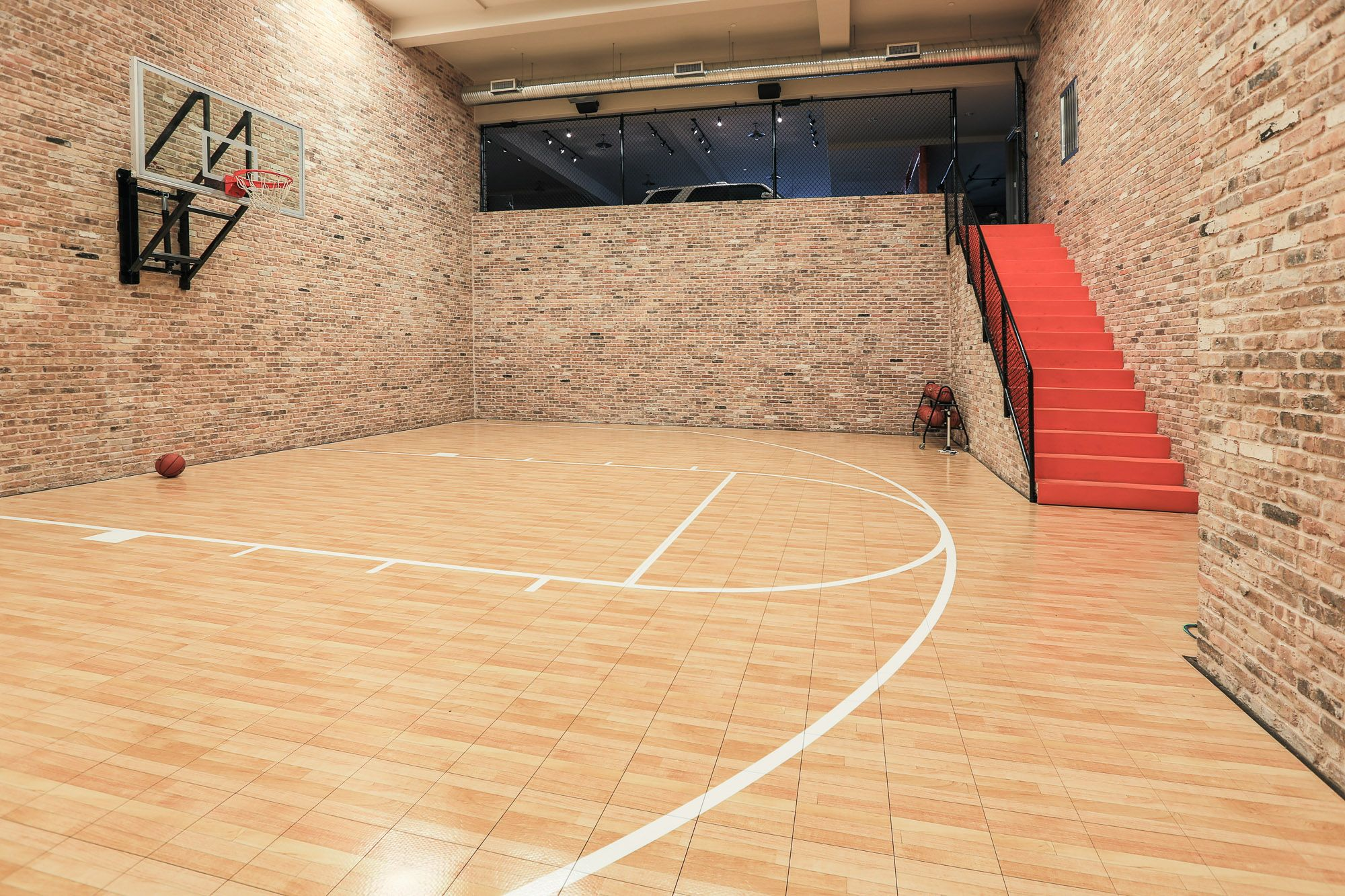 Basement basketball court nice use of stonework steps for How much is an indoor basketball court
