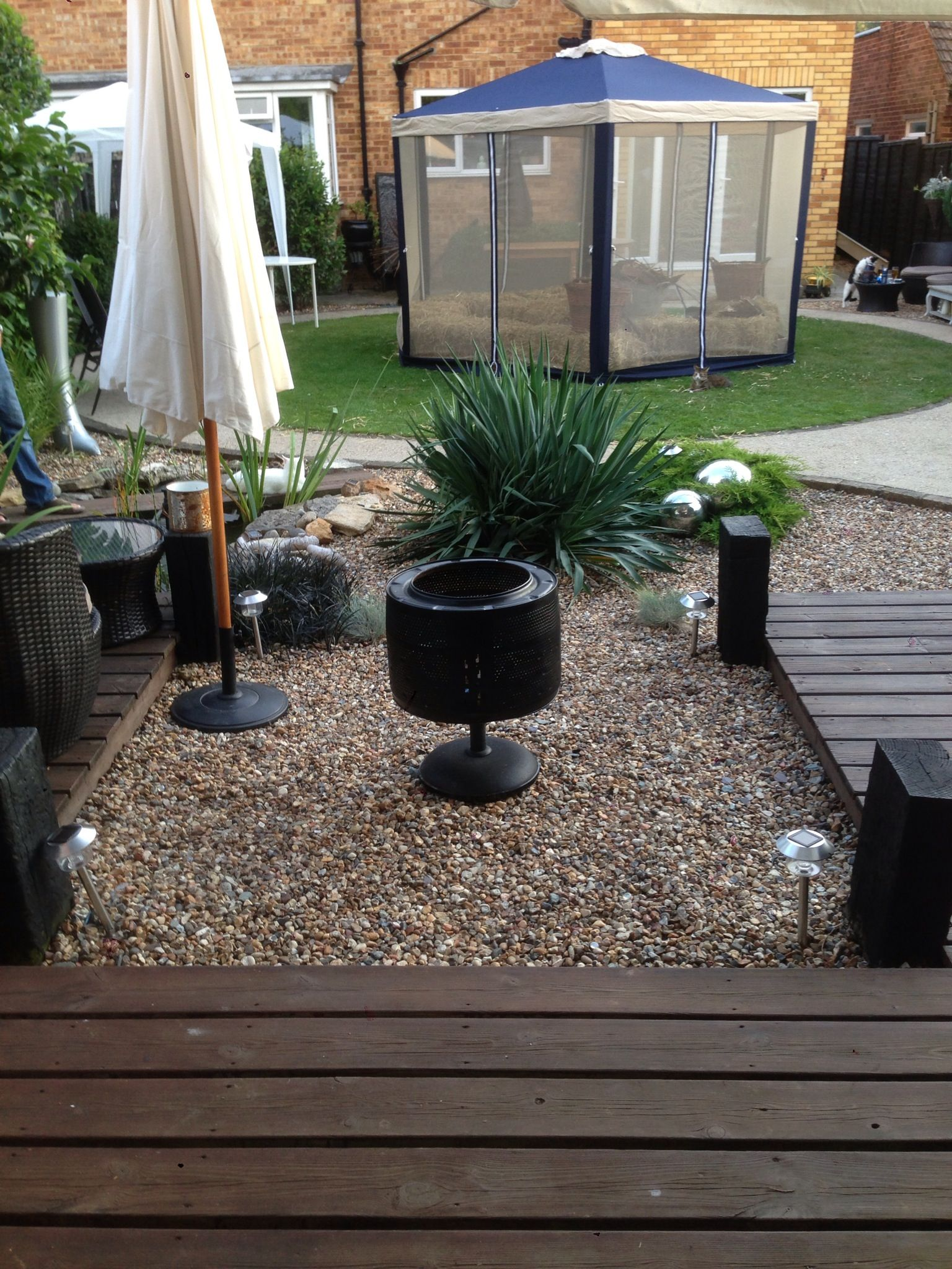 our fire pit i made from a washing machine drum u0026 a parasol base