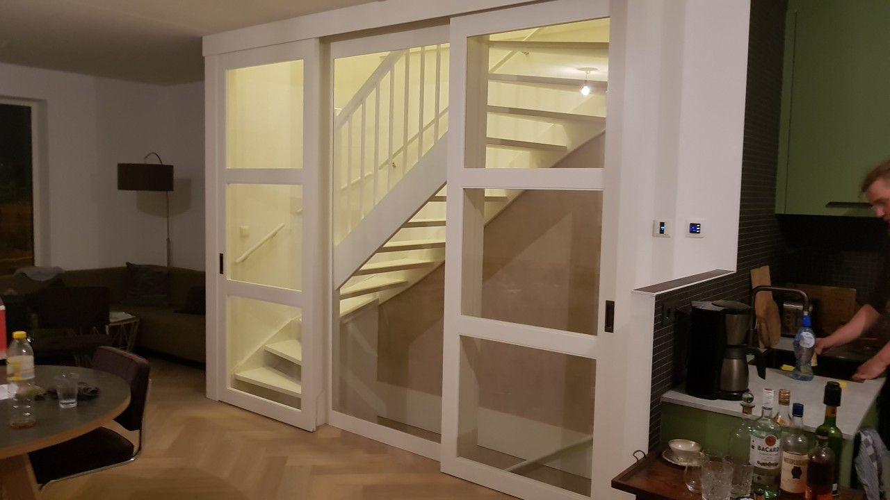 Rimo schuifdeuren op maat voor open trap midden gedeelte voorzien