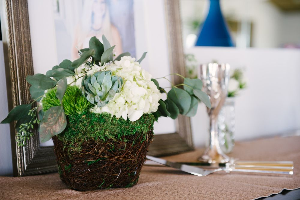 Gen's Wedding   Wedding in Tampa Bay   Beautiful white and green centerpiece made with white hydrangea, green trick, seeded eucalyptus  and succulents in a moss basket. #andrealaynefloraldesign #tampaweddings