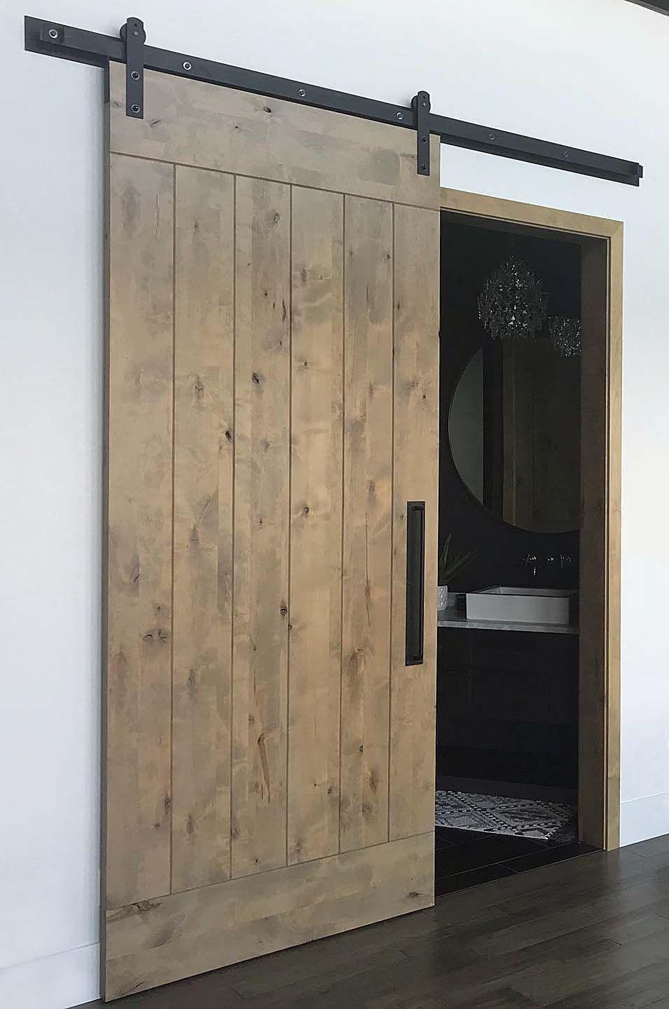 Handsome Plank Style Barn Door In Knotty Alder Stained With Minwax Weathered Oak Rustica Hardware Finis Weathered Oak Stain Stained Doors Knotty Alder Doors