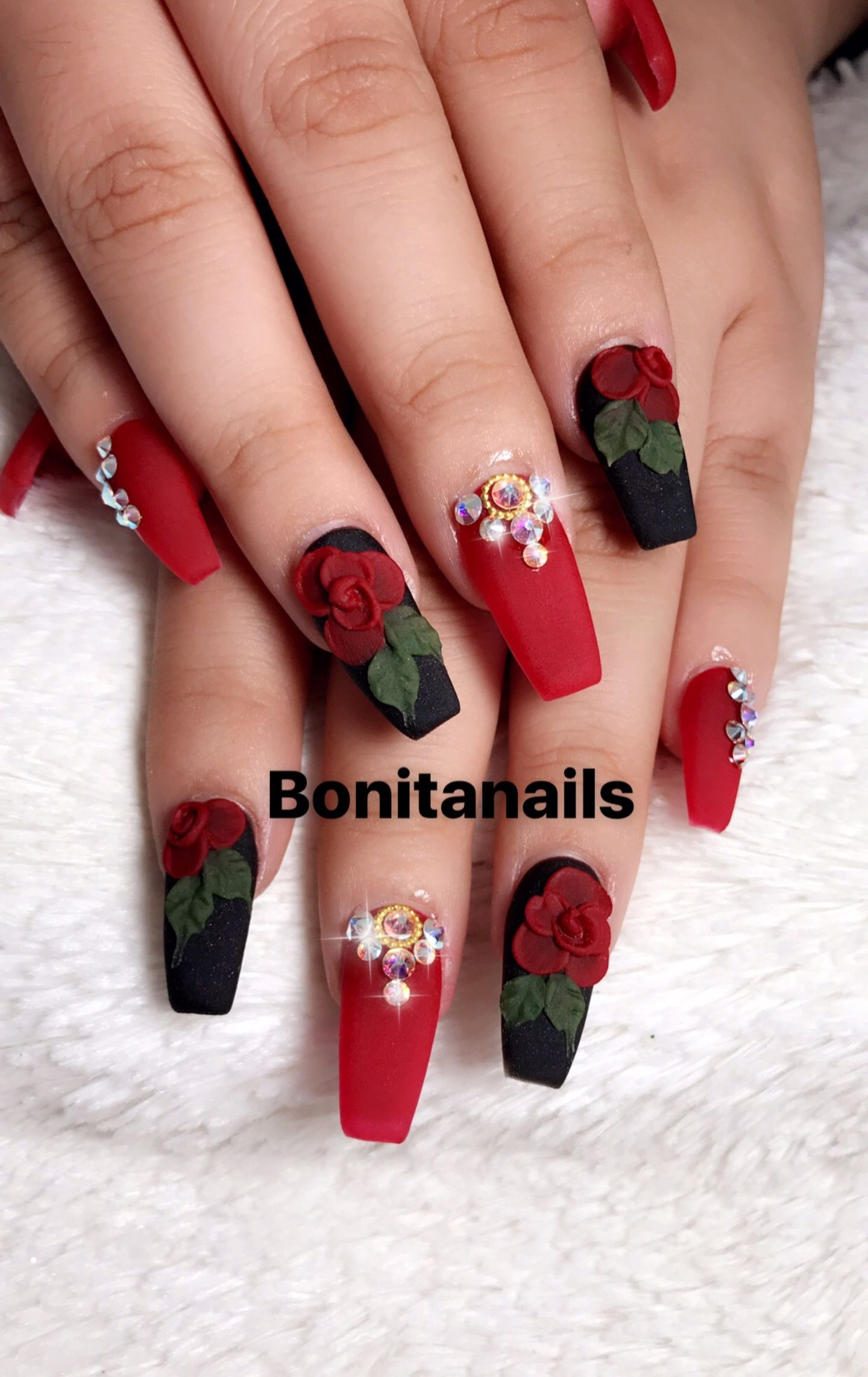 Black and red nails wtih pearls and red acrylic roses nail art